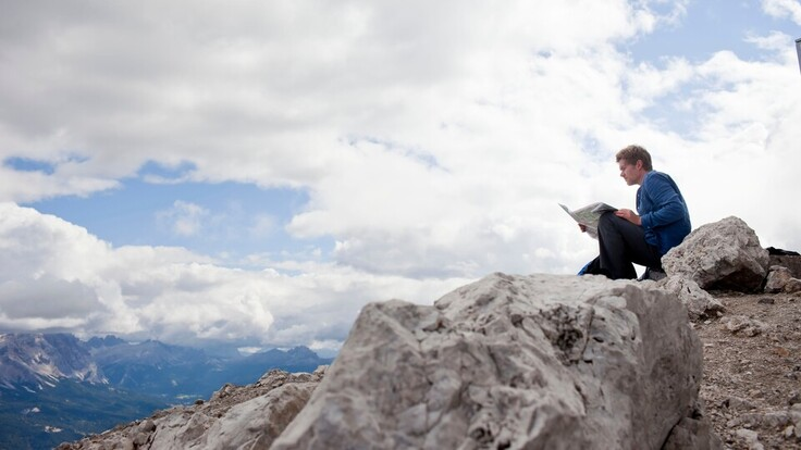 Man on mountain, rock, sitting